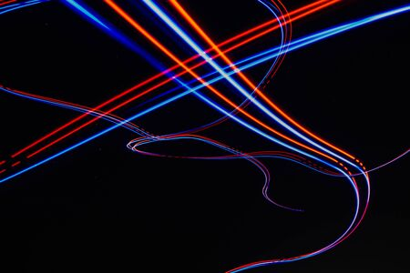 ABSTRACT LIGHT TRAILS FROM DRONE IN NIGHT SKY
