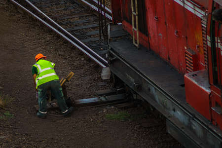 Points man signalman changing the tracks or points of the train. Concept: Dangerous and old jobs