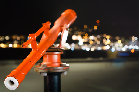 Telescope looking out into defocused lights producing bokeh. shallow depth of field shot. Metaphor of looking for direction  Night time in Wellington, New Zealand.