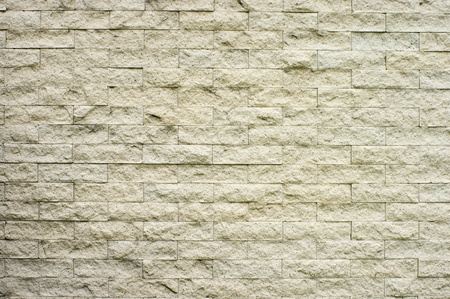The old white brick wall for a background or structures
