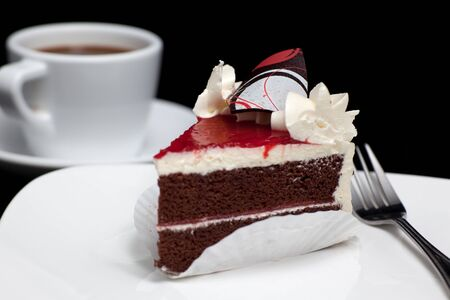 chocolate cake with cherry isolated on black background