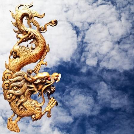 Golden dragon chinese statue on the sky