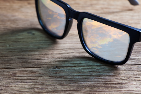 sunglasses on a wooden table closeup Stock Photo