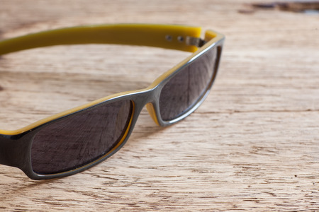 vintage sunglasses on a wooden table closeup
