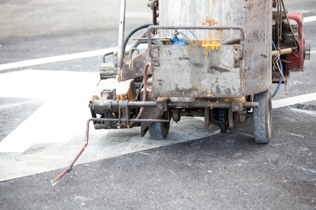 thermoplastic: Thermoplastic spray marking machine during road construction works
