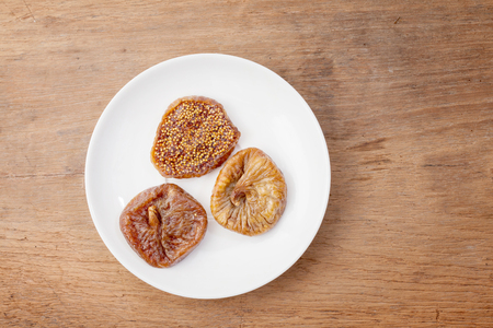 close up: delicious dried figs on wooden close up