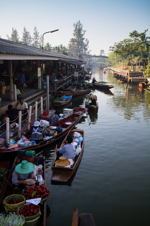 SAMUT SONGKHRAM, THAILAND - Fabruary 4, 2017 : Thaka Floating market Ampahwa on February 4, 2017 in Samut Songkhram, Thailand. Thaka is genuine and charming view of a traditional Thai floating market. Stock Photo