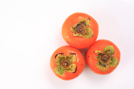 fresh persimmon top view on white background