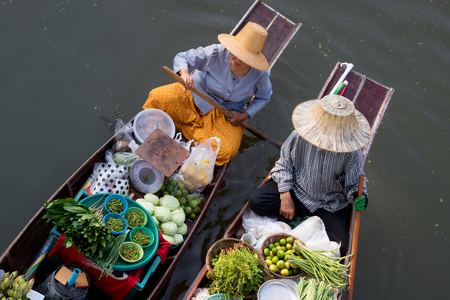 Thaka is genuine and charming view of a traditional Thai floating market. Stock Photo