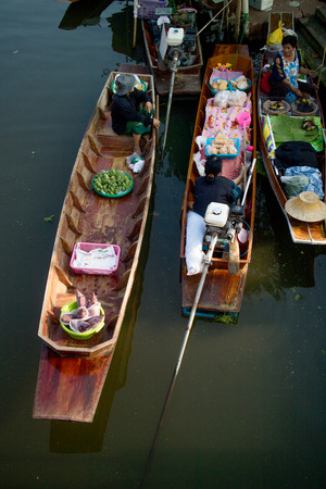 SAMUT SONGKHRAM, THAILAND - Fabruary 4, 2017 : Thaka Floating market Ampahwa on February 4, 2017 in Samut Songkhram, Thailand. Thaka is genuine and charming view of a traditional Thai floating market. Editorial
