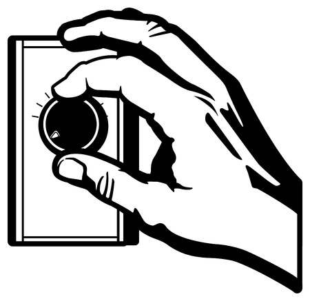 Hand Adjusting a Thermostat Knob