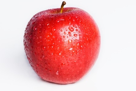 A single red apple isolated on white with water droplets on it. Stock Photo