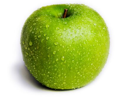 A single green apple isolated on white with water droplets on it. Stock Photo