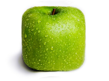 A single green apple in the shape of a square isolated on white with water droplets on it. Stock Photo