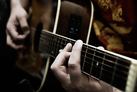 A close up of a guitarists hands playing acoustic guitar. Narrow depth of field. Stock Photo - 4023920