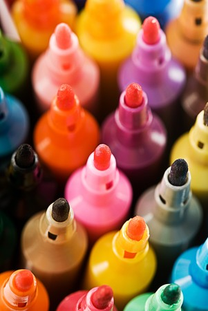Close up view of the tip of many coloured markers.