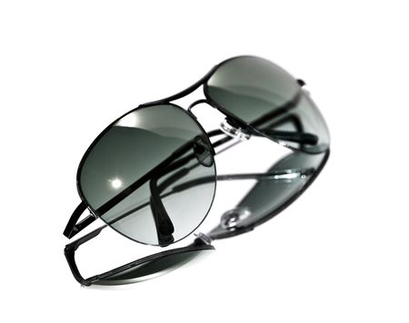 Aviator style sunglasses isolated on a white background. Shallow depth of field.