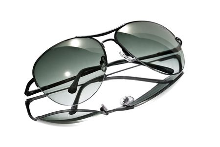 protecting spectacles: Aviator style sunglasses isolated on a white background.