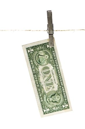 US $1 note  pegged to a line. Isolated on white.