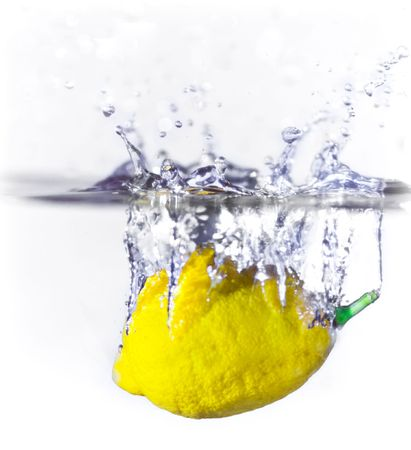 A lemon dropping into water creating a splash