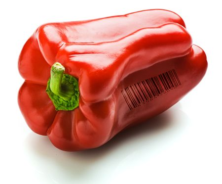 A whole red capsicum. Isolated on white. A generic (not real) barcode printed on the capsicum. Stock Photo - 4580214