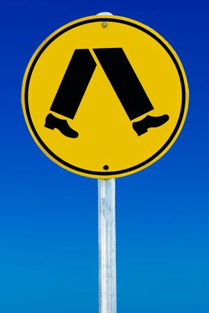 A pedestrian crossing sign consisting of a pair of legs in a circle isolated on a blue gradient sky.