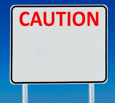 ad: Caution road sign isolated on a blue graduated sky.