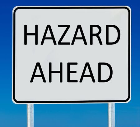 Hazard Ahead road sign isolated on a blue graduated sky. Stock Photo