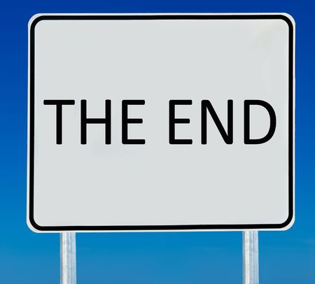the end: The End sign isolated on a blue graduated sky. Stock Photo