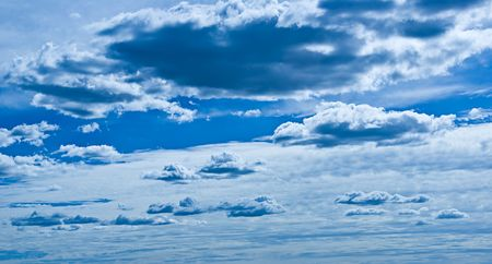 Background image made up of blue sky with clouds. Stock Photo