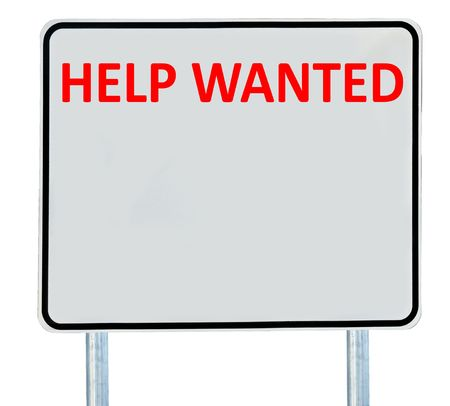A Help Wanted sign isolated on white. photo