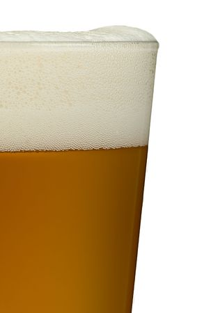 A close up of a glass of beer on a white background. Beer is a lovely golden colour with white frothy bubbles on top. Stock Photo