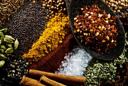 Cumin, Paprika, Cardamon, Cinnamon, Mustard Seed, Corriander Seed, Tumeric, Salt, Pepper, Fennel, Cloves and Chilli. Stock Photo