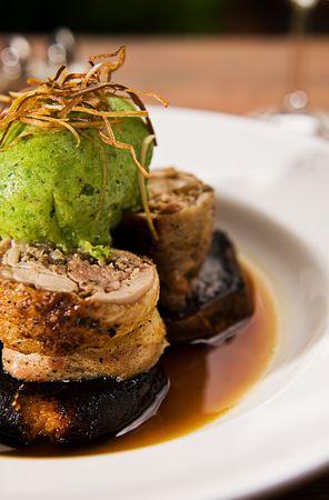 Chicken roulade with a Jerusalem artichoke & pork farce, sweet potato wedges, green pea  dumpling & glaze