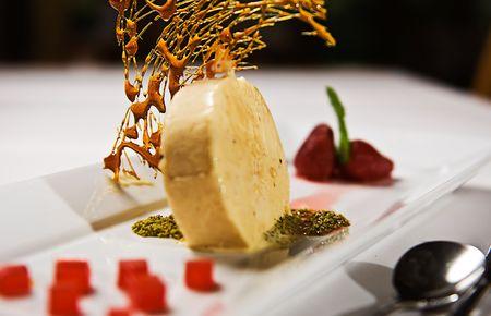 A dessert selection plate of icecream, strawberries etc.