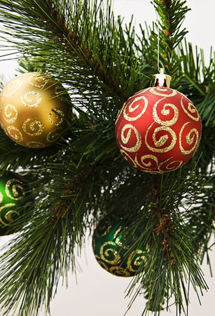 Close up of Christmas decorations on a christmas tree. Isolated on white Stock Photo