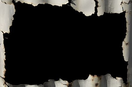 Rusty iron sheet making a frame around a black interior for copy  text.
