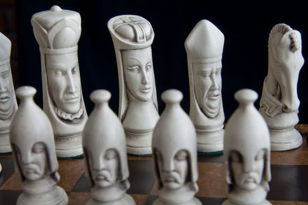 Beautiful chess pieces on a chess board photo