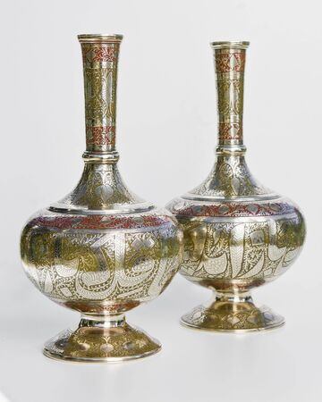 A pair of Brass Vase with great pattern and texture. photo