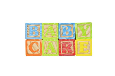 Childrens Alphabet Blocks spelling the words baby care Stock Photo - 7280090