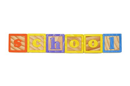 Childrens Alphabet Blocks spelling the word School in lower case letters Stock Photo - 7280083