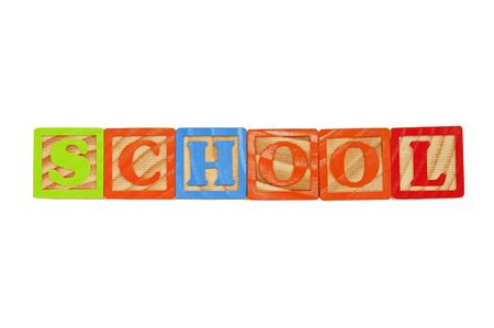 Childrens Alphabet Blocks spelling the word School in capital letters Stock Photo - 7280086