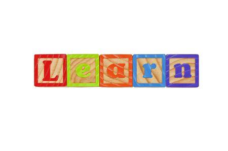 Childrens Alphabet Blocks spelling the word Learn Stock Photo