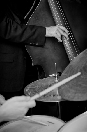 Double bass and drummer in a live jazz band Stock Photo