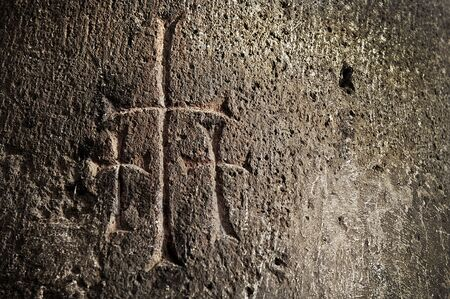 Three crosses carved into the wall of an ancient church in Armenia photo