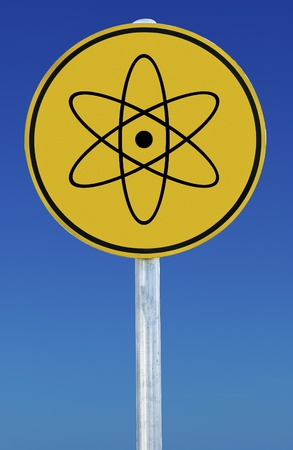 A nuclear sign isolated on a blue graduated sky. photo