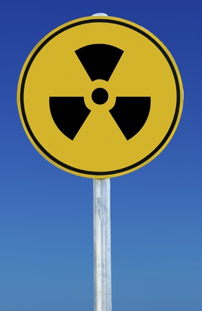A radioactive sign isolated on a blue graduated sky. Stock Photo - 9138264