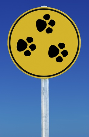 animal paw prints: Circular Sign with animal paw prints on it on a blue sky background