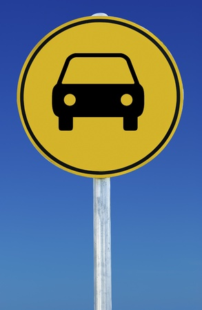 Picture of a car on a yellow road sign on a blue background. photo