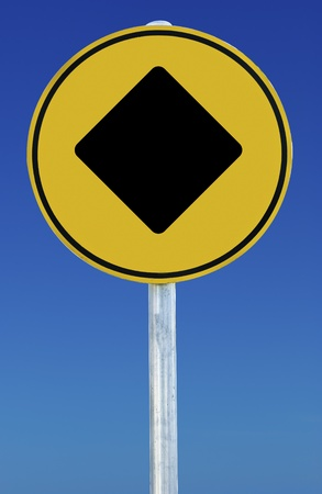 A diamond on a yellow sign on a blue background photo